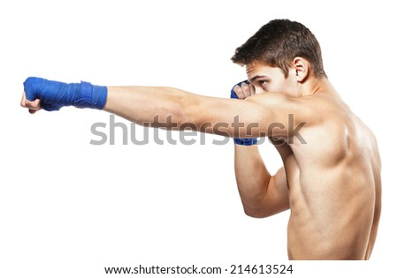 Side view of young handsome male boxer making punches during training isolated on white background - stock photo