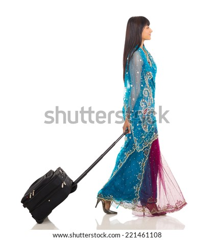 side view of young indian woman traveling isolated on white - stock photo