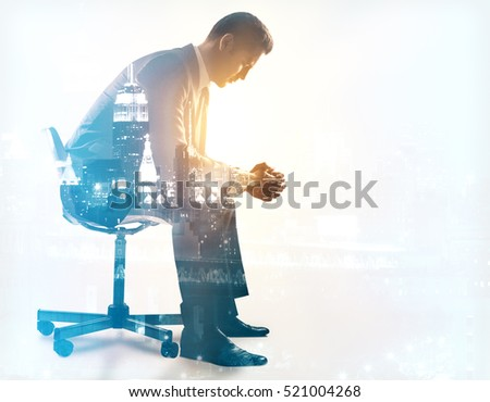 Side view of young man sitting on chair. City background. Double exposure. Depression concept