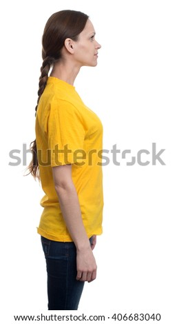 Side view of young pretty woman in yellow t-shirt. Isolated on white background - stock photo