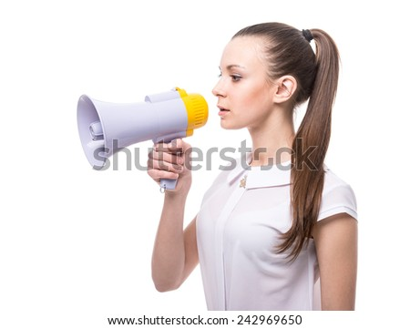 Side view of young woman speaks in a megaphone on white background. - stock photo