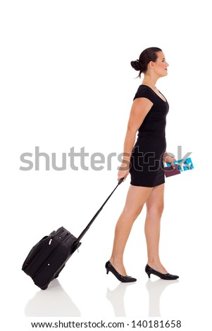 side view of young woman travelling isolated on white background