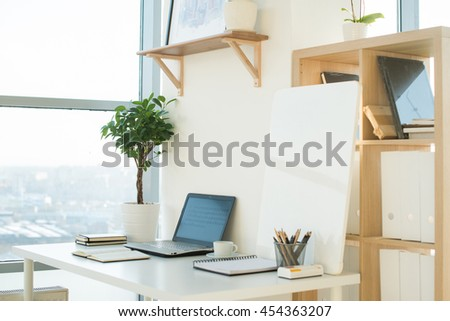 Side View Picture Of Studio Workplace With Blank Notebook Laptop Designer Comfortable Work Table