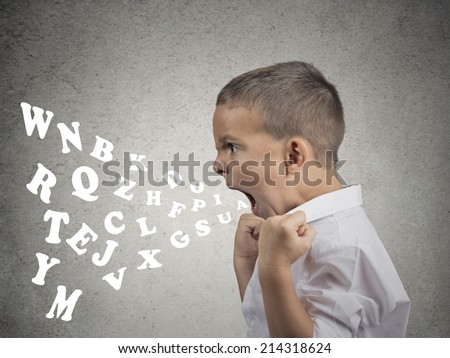 Side view portrait angry child screaming, alphabet letters coming out of his mouth, isolated grey wall background. Negative human face expressions, emotion, reaction. Conflict, confrontation concept - stock photo