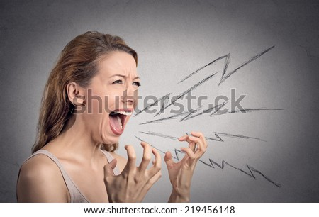 Side view portrait angry woman screaming, wide open mouth, hysterical isolated grey wall background. Negative human face expressions, emotion, bad feelings reaction. Conflict, confrontation concept - stock photo
