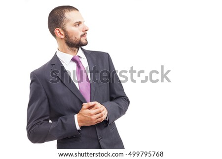 Side view portrait of a handsome businessman looking at copyspace, isolated on white background