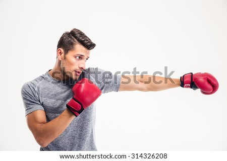Side view portrait of a handsome man boxing isolated on a white background - stock photo
