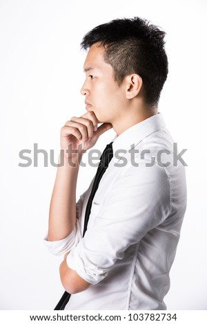 Side view portrait of a Happy Asian business man. - stock photo