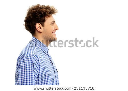 Side view portrait of a happy man isolated on a white background - stock photo