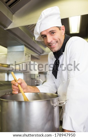 Side view portrait of a male chef preparing food in the kitchen