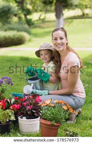 Side view portrait of a mother and daughter engaged in gardening