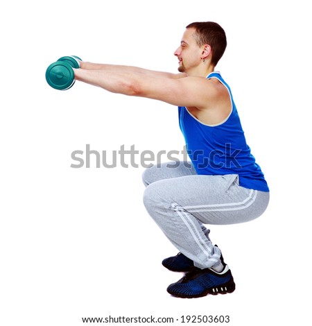 Side view portrait of a sport man doing exercises with dumbbells over white background