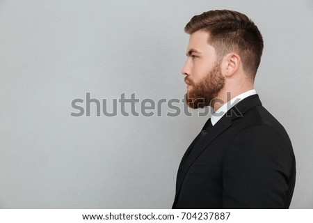Portrait Of A Mid Man With Full Beard Side View Stock Photo