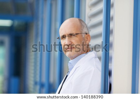 Side view portrait of confident male doctor - stock photo