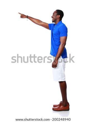 Side view portrait of happy african man pointing at something over white background - stock photo