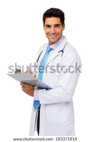 Side view portrait of happy male doctor writing on clipboard white standing over white background. Vertical shot. - stock photo