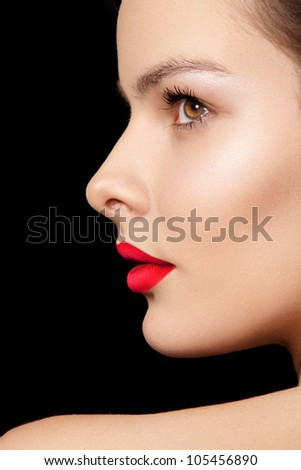 Side view portrait. Sexy woman model with bright red lips makeup, cheekbones and healthy shiny skin. Evening glamour style, fashion make-up - stock photo