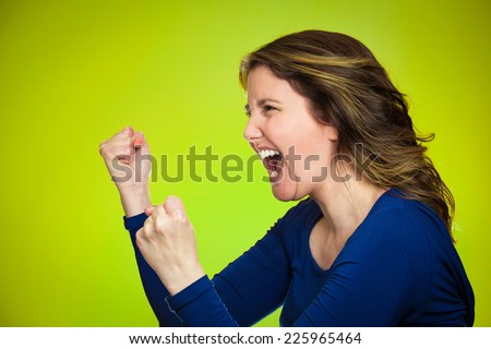 Side view profile portrait beautiful angry woman screaming isolated on green background. Negative human emotions, face expression, feelings, anger management problems  - stock photo