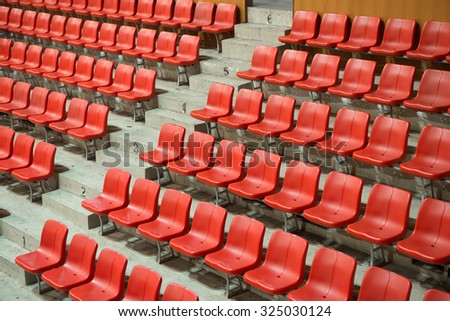 side view red stadium seats - stock photo