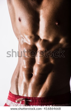 Side-view silhouette of young muscular athletic sexy shirtless hot man posing showing wet sport body with cool pectoral abs muscle strong breast biceps studio on white. Beads sweat training gym.  - stock photo