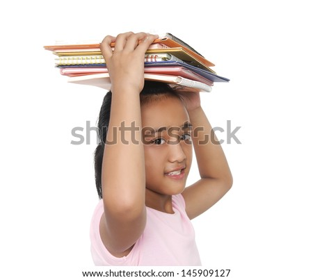 Side view Student child with many books on his head