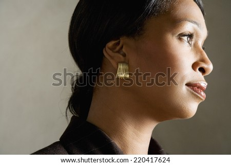 Side view studio shot of African woman - stock photo