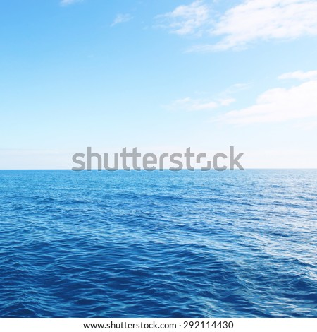 Side view to sea on summer day in sunlight - stock photo