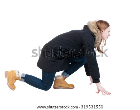 side view woman in start position. Standing young girl in parka. Rear view people collection.  backside view of person.  Isolated over white background. - stock photo