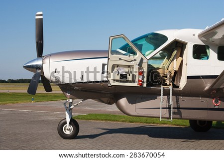 sideview of the front part of Cessna caravan airplane - stock photo