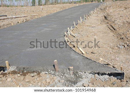 Sidewalk repaired with newly poured cement - stock photo