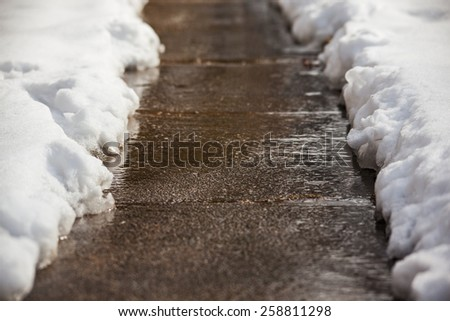 Sidewalk shoveled after a snowfall in winter - stock photo