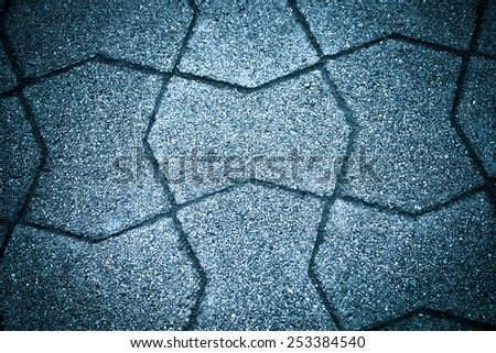 Sidewalk tile made of natural stones. Background. Toned. - stock photo