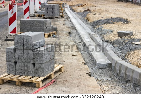Sidewalk under construction, curb and gutter installation in progress. Selective focus and shallow dof. - stock photo