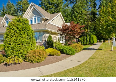 Sidewalk with a beautiful outdoor landscape and a row of trees. - stock photo