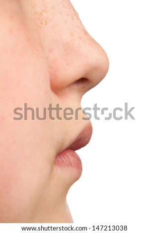 Sideways closeup shot of nose and mouth in a teenagers face.