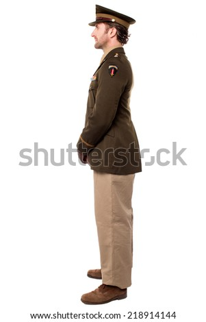 Sideways image of young military man posing - stock photo