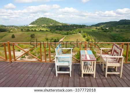 Sideways view of beautiful wood balcony deck , Wooden terrace. - stock photo