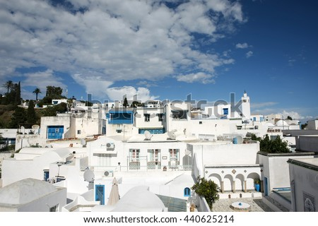 SIDI BOU SAID, TUNISIA - SEPTEMBER 14, 2012: A view of architecture in Sidi Bou Said, Tunisia. Sidi Bou Said is a town in northern Tunisia known for the use of blue and white in it's architecture. - stock photo