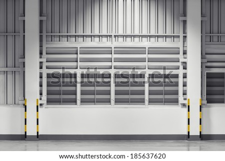 Siding sheet and louver use for wall of factory, nighttime. - stock photo