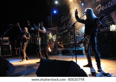 SIEDLCE, POLAND - JUNE 26: Acid Drinkers performs on stage at Siedlecki Rock Open Air Festival on June 26, 2011 in Siedlce, Poland