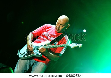 SIEDLCE, POLAND - JUNE 09: Dariusz Kozakiewicz of Perfect performs on stage at Siedlecki Rock Open Air Festival on June 09, 2012 in Siedlce, Poland - stock photo