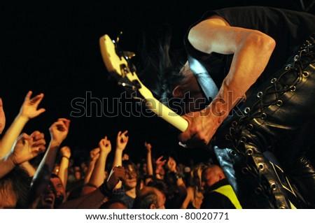 SIEDLCE, POLAND - JUNE 26: Titus of Acid Drinkers headbangs on stage at Siedlecki Rock Open Air Festival on June 26, 2011 in Siedlce, Poland - stock photo