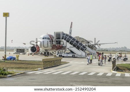 SIEM REAP, CAMBODIA - 2015: AirAsia A320-200 aircraft on January 25, 2015 at Siem Reap Airport, Siem Reap, Cambodia. AirAsia is the largest low-cost air company and top-rated lowcoster. - stock photo