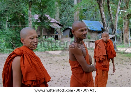 SIEM REAP, CAMBODIA -  CIRCA NOVEMBER 2015: Apprentice monks in the school playground circa November 2015 in Siem Reap. Village school for monks near Angkor Wat.