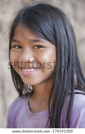 SIEM REAP, CAMBODIA - DEC 30: An unidentified Khmer girl poses for a photo on December 30, 2012 in Siem Reap, Cambodia.