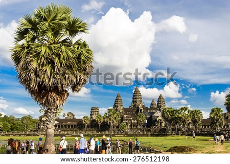 SIEM REAP, CAMBODIA - DECEMBER 5: Crowd of people at Angkor Wat on December 5, 2014. It is a temple complex in Cambodia and the largest religious monument in the world. - stock photo