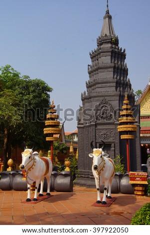 SIEM REAP, CAMBODIA - FEB 16, 2015 - Statues of white Brahma Bulls,  Wat Damnak monastery in Siem Reap,  Cambodia - stock photo