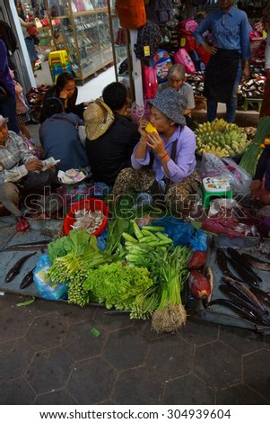 SIEM REAP, CAMBODIA - FEB 16, 2015 - Woman selling vegetables in the market of  Siem Reap,  Cambodia
