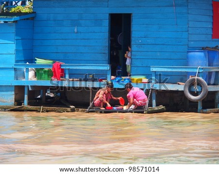 SIEM REAP, CAMBODIA - Mar 20: Cambodian people live beside Tonle Sap Lake in Siem Reap, Cambodia on March 20, 2012. Tonle Sap is the largest freshwater lake in SE Asia peaking