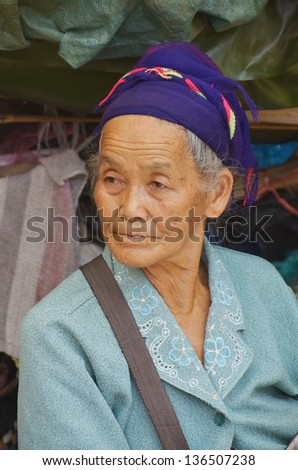 SIEM REAP CAMBODIA MARCH 27: Portrait of an unidentified old buddhist woman on march 27 2013 in Siem Reap, Cambodia. Theravada Buddhism is practiced by over 95% of Cambodians. - stock photo